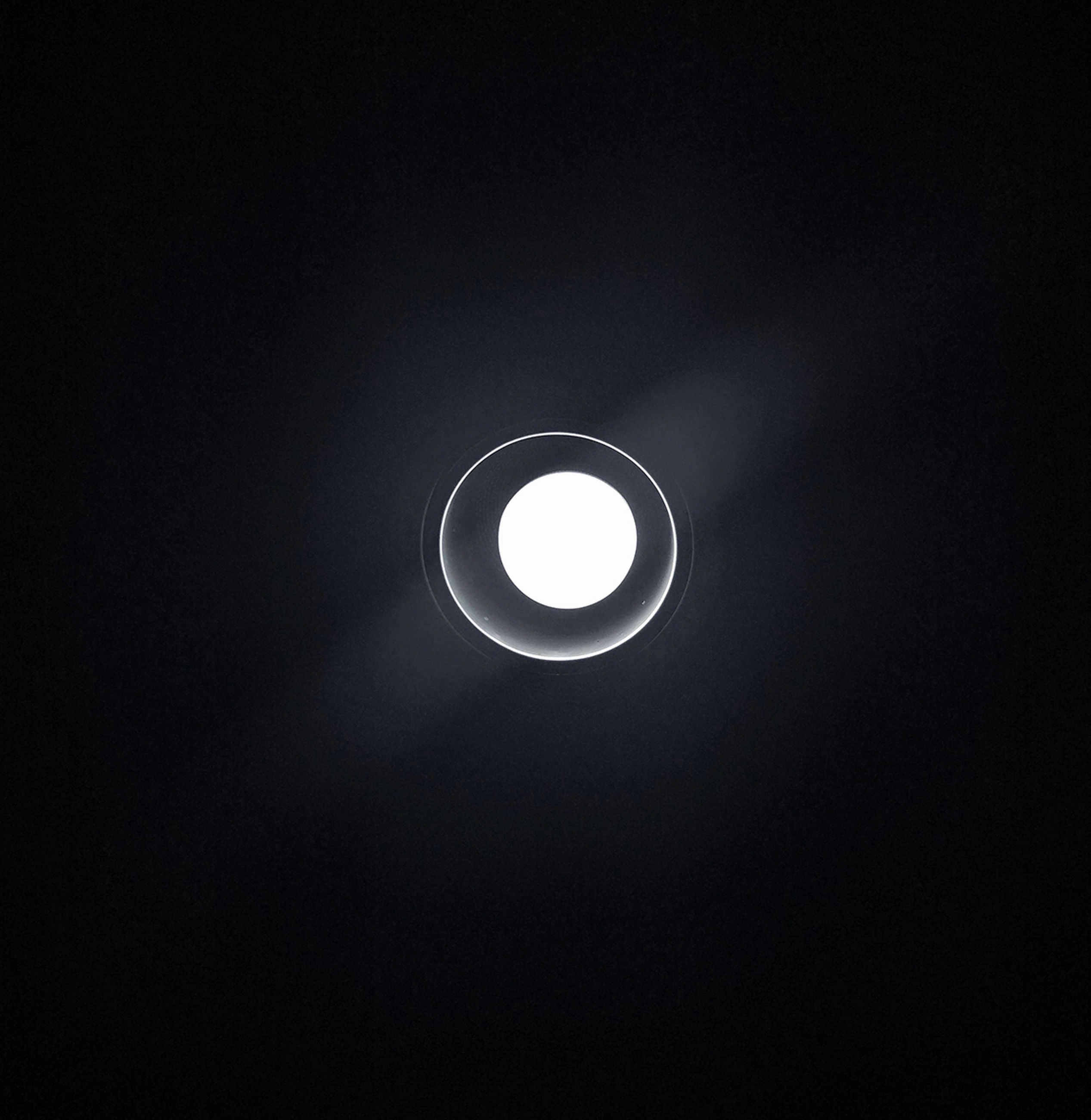 low angle view, black background, no people, electricity, night, astronomy, illuminated, sky, indoors, nature, solar eclipse