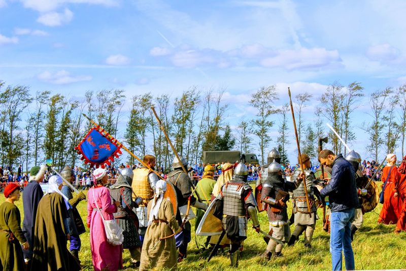 Crowd in traditional clothing against sky