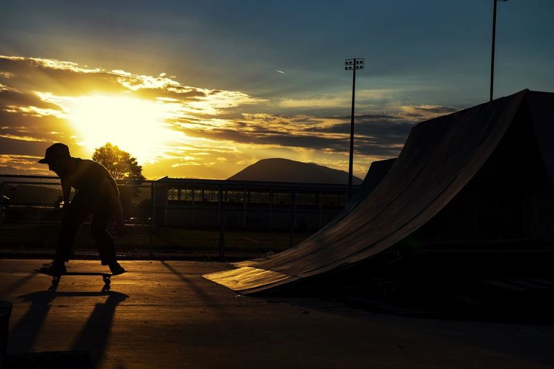 Silhouette Man Skating Against Sky During Sunset