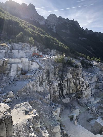 Scenic view of marble cave against sky