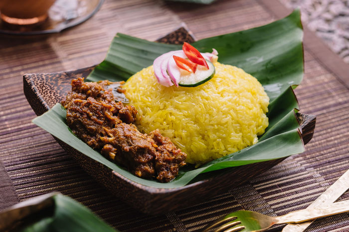 Pulut Kuning Asian Cuisine Malaysian Food Nasi Kunyit Asian Food Banana Leaf Close-up Day Food Food And Drink Freshness Indoors  Indulgence No People Plate Ready-to-eat Rice - Food Staple Serving Size Sweet Food Table