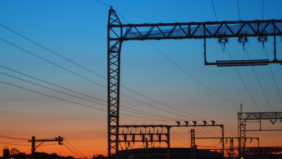 Architecture Blue Built Structure Cable Clear Sky Connection Dusk Electricity  Electricity Pylon Fuel And Power Generation Low Angle View Orange Color Outdoors Power Cable Power Line  Power Supply Silhouette Sky Sunset Technology