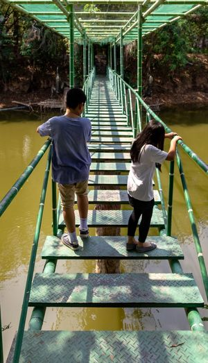 Adventure Bridge Bridge - Man Made Structure Danger Dangerous Rear View Full Length Child Childhood Two People Nature Walking Day Togetherness Casual Clothing Real People People Outdoors Footbridge Park - Man Made Space Sibling Beauty In Nature Sister Girls Boys Architecture