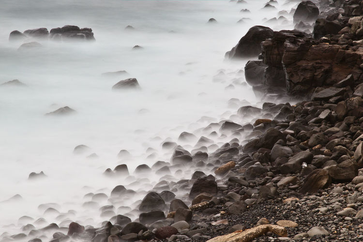 Rock Solid Rock - Object Beauty In Nature Water No People Nature Day Land Sea Scenics - Nature Tranquility Motion Outdoors Long Exposure Winter Cold Temperature Rock Formation Flowing Water Power In Nature