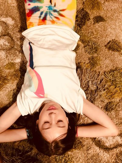 Lying Down Real People Lifestyles Women Leisure Activity Relaxation High Angle View Females One Person Childhood Eyes Closed  Child Front View Girls Portrait Lying On Back Resting Directly Above Outdoors