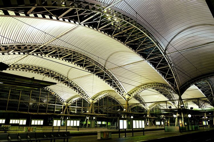 Low Angle View Of Ceiling At Illuminated Leuven Railway Station