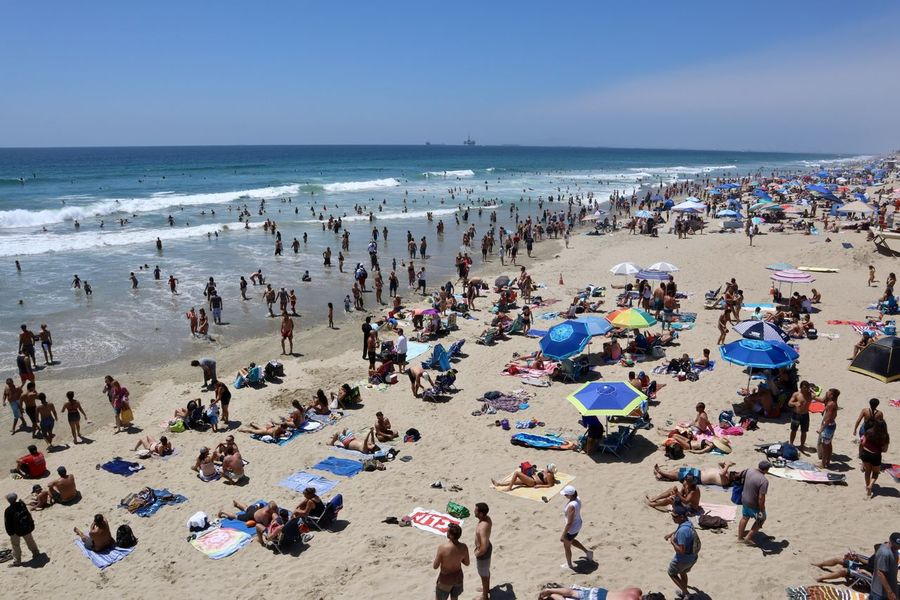 crowds of people at the beach during a Southern California heat wave Busy Day Hot Day Huntington Beach CA Beach Day Beach Vacation Beachgoers Family Fun Heat Wave Lots Of People Ocean Orange County Pacific Ocean Sand Southern California Beach Summer Day