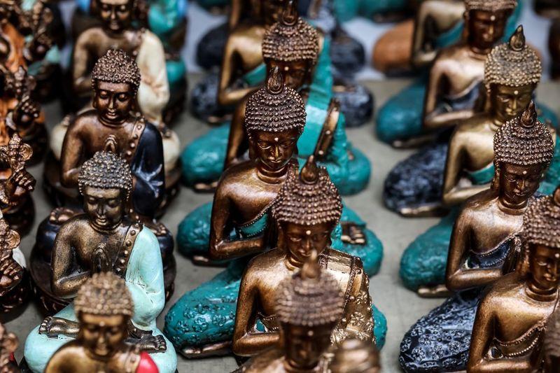 High angle view of buddha figurines for sale