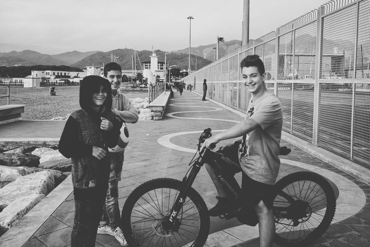 Bicycle People Outdoors Friendship Biker Smiling Full Length Real People Streetphoto_bw Streetphotography Monochrome Photography Blackandwhite Blackandwhite Photography Black & White Monochrome Fuji X70 Fujifilm_xseries Urban Photography Vacations Sunny Human Face Front Camera Smiling Face Smilerforever Funtime