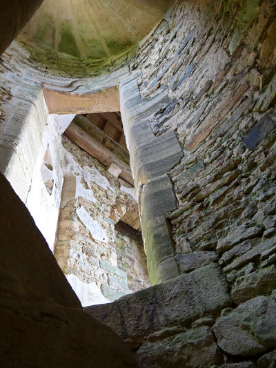 Inside the round tower of Gratot castle, Normandy Ancient Architectural Feature Architecture Bad Condition Built Structure Castle Ceiling Chateau Gratot Day France French Castle Historic History Indoors  Interior Low Angle View Medieval No People Normandy Stone Material Stone Wall The Past Weathered
