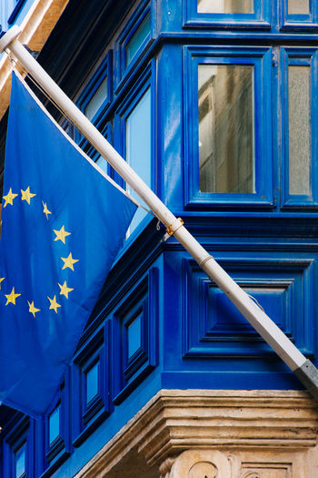 Low angle view of european union flag on building