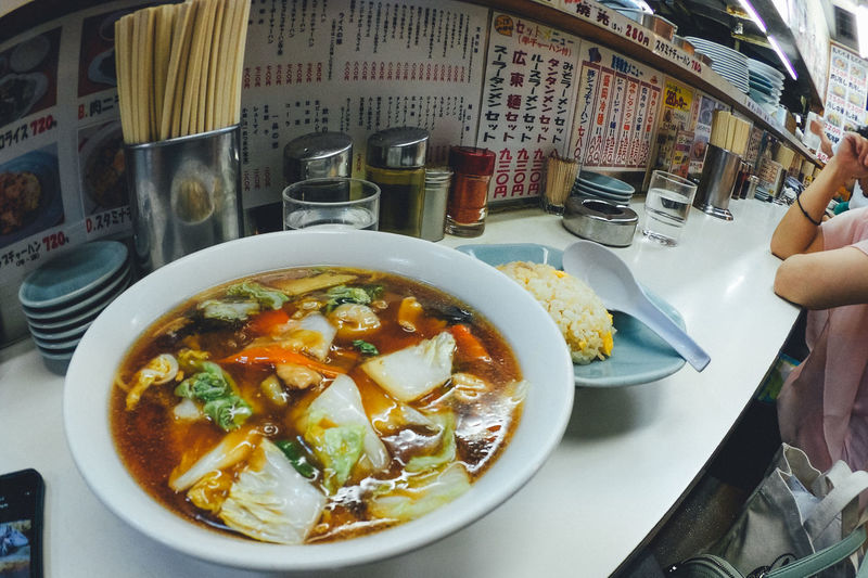 Bowl Chinese Food Close-up Day Food Food And Drink Freshness Healthy Eating High Angle View Human Hand Indoors  Japanese Culture Lifestyles One Person People Plate Ramen Ready-to-eat Real People Restaurant Serving Size Soup Table