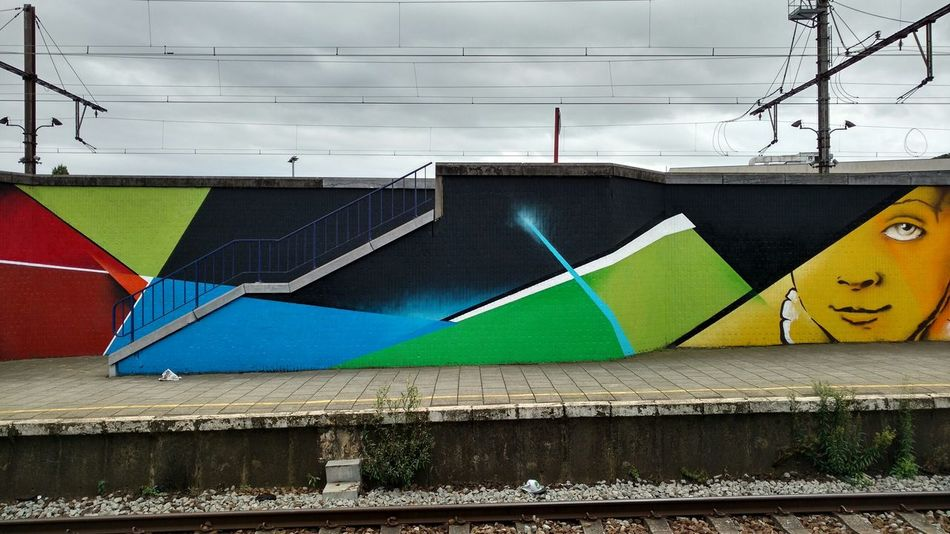 Green with a touch of blue, black and yellow. Public Transportation Commuting NMBS Colors Antwerp, Belgium