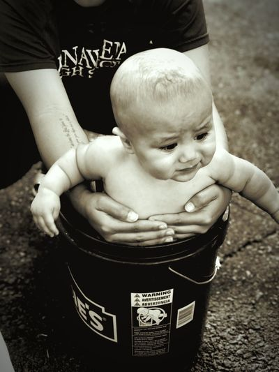 The Old Fashion Way!! Bath Time Bucket EyeEm Selects Baby Childhood Holding Togetherness Bonding Close-up Outdoors EyeEmNewHere