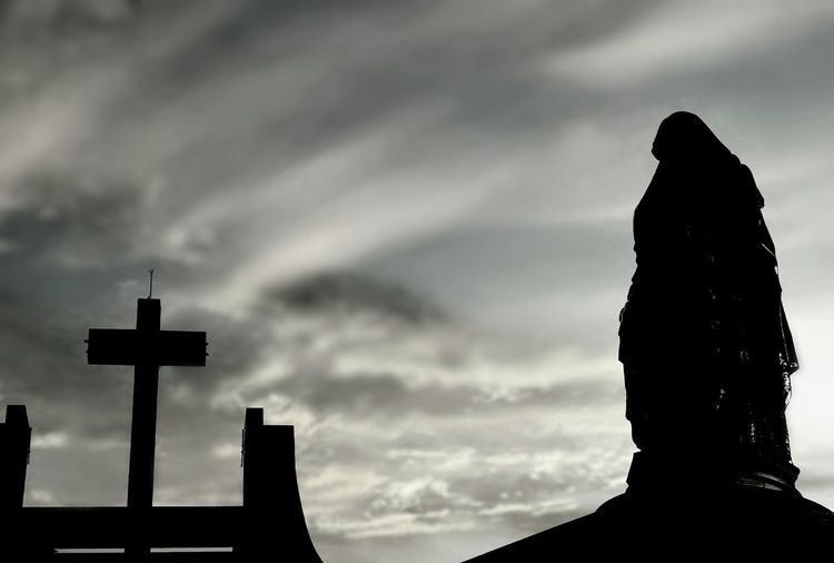 Silhouette of the large Saint Ann statue and cross on church with blurred sunrise sky background on black and white style in art of religion and architecture design concept Religion Large Saint Ann Statue Outdoor Blur Background Sunrise Clouds Black And White Faith Worship Shadow Silhouette Architecture Catholic Christianity City Cross Silhouette Forgiveness Spirituality Religion Sky Cloud - Sky Architecture Crucifix Cross Shape Lightning Dramatic Sky Jesus Christ