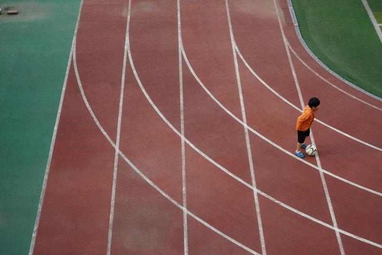 Rear view of man running