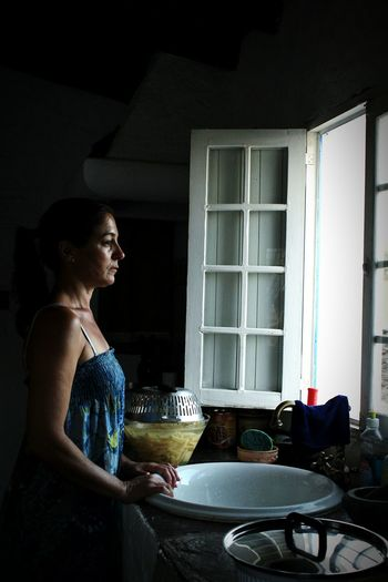 Close-up of young woman standing in kitchen