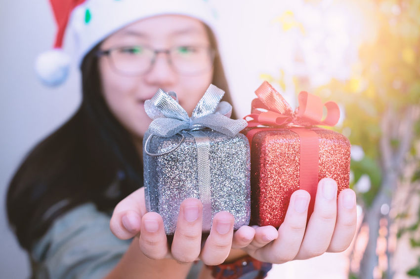 Celebration Gift One Person Front View Portrait Holiday Holding Christmas Focus On Foreground Headshot Emotion Surprise Event Real People Gift Box Hand Present New Year Reward Handling Happy Face