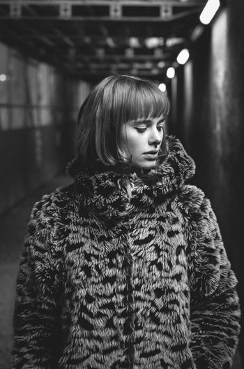 Beautiful Young Woman Wearing Fur Coat Standing In Subway