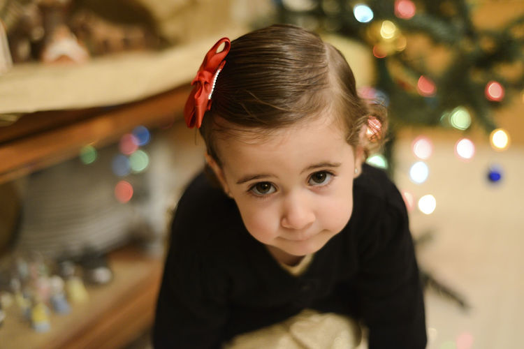 High angle portrait of cute girl at home during christmas