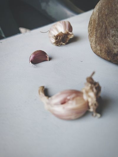 High angle view of garlic pieces on table