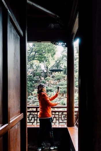Capturing... Smartphonephotography Window Indoors  Rear View One Person Real People Standing Transparent Lifestyles Women Built Structure Leisure Activity Three Quarter Length