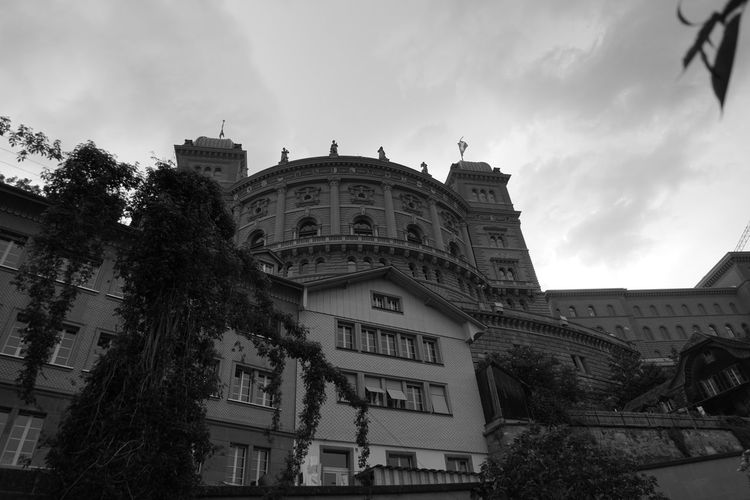 Low angle view of federal palace of switzerland against sky