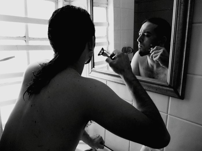 Close-up of man shaving
