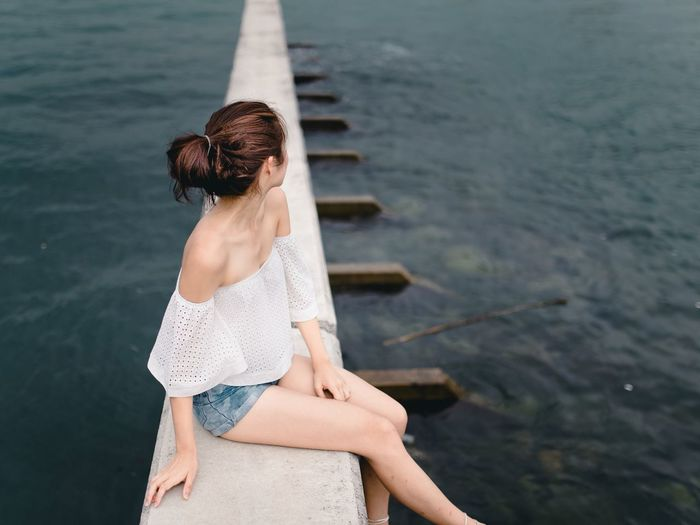 by the sea Water Summer Beauty Outdoors Sea One Woman Only Relaxation Beautiful People Women Of EyeEm Natural Light Portrait Nature Water_collection Nature Photography Clean Architecture_collection Architecture Long Goodbye TCPM The Portraitist - 2017 EyeEm Awards The Great Outdoors - 2017 EyeEm Awards