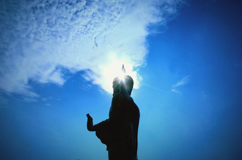 Buddha Real People Blue One Person Leisure Activity Low Angle View Women Lifestyles Sky Men Silhouette Indoors  Day Isolated Buddhist Temple Buddha Statue Flare