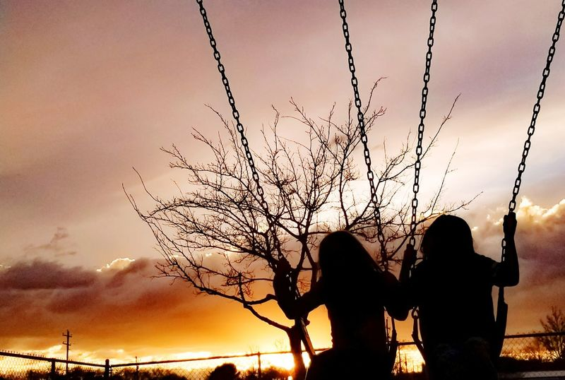 friends swinging Dark darkness and light High Contrast Portrait Clouclcl Silhouette Sunset Togetherness Sky Flying Outdoors Nature Two People People Day Tree Beauty In Nature