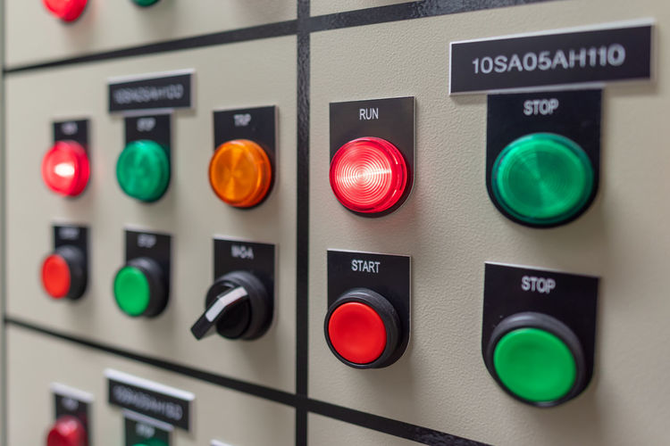 Control Technology Green Color Push Button No People Close-up Control Panel Communication Sign Industry Text Indoors  Security Focus On Foreground Illuminated Machinery Western Script Safety Equipment Red
