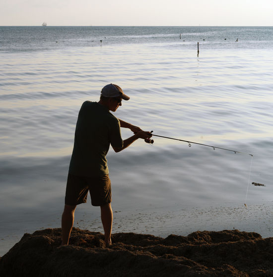 Sea Real People Fishing One Person Fishing Rod Beauty In Nature Lifestyles Activity Leisure Activity Scenics - Nature Fisherman Outdoors Florida Keys Florida Sunset Key West Sunset Natural Light Portrait