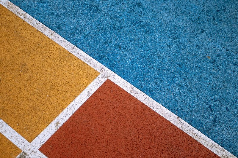 Basketball court lines and color No People Full Frame High Angle View Sport Day Pattern 17.62° Blue Brown Backgrounds Textured  White Color Geometric Shape Single Line Court Shape Marking Outdoors