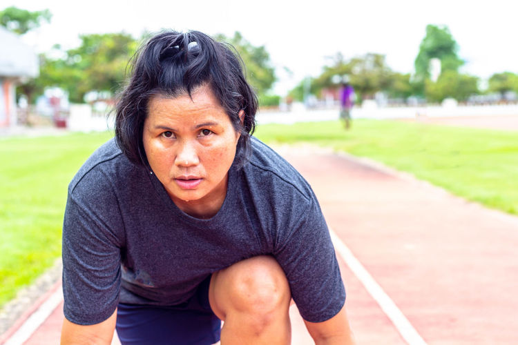 Portrait Of Mature Woman On Sports Track
