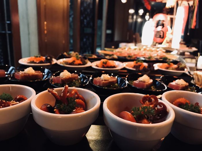 Seafood in bowls on table at restaurant