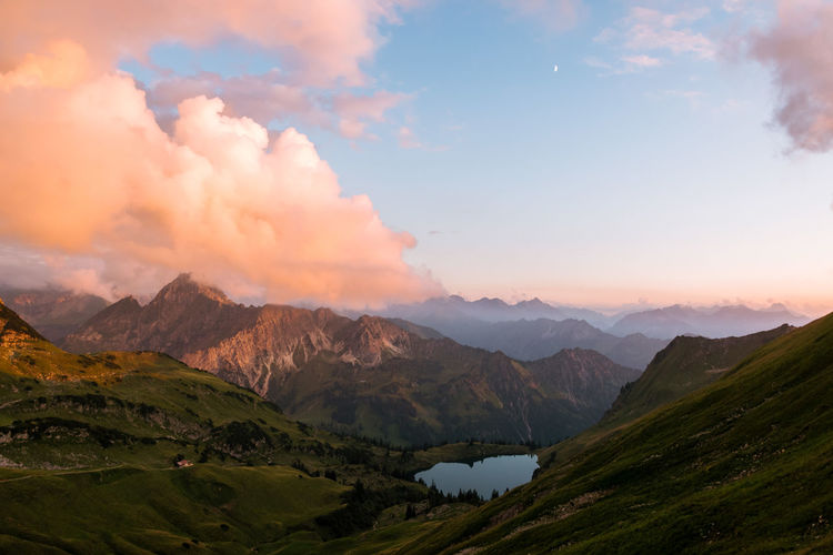 Sunset in the Algau region of Germany- mountain lake and ridge during golden hour with dramatic orange clouds Beauty In Nature Cloud - Sky Day Landscape Mountain Mountain Range Nature No People Outdoors Scenics Sky Sunset Tranquil Scene Tranquility