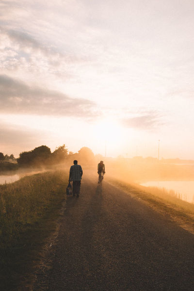 On my morning walk after a sleepless night i stumbled upon this scene! I just loved the 2 worlds in one picture | Rural Scene Two People Canon Live For The Story Misty Morning Heemskerk The Great Outdoors - 2017 EyeEm Awards EyeEmNewHere Foggy Morning Full Length Exploring New Ground Dawn Of A New Day Landscape Bicycles Tour De France On The Way Goldenhour EyeEm Nature Lover Place Of Heart Calmness Wandering Homeless Homeless Man 2 Worlds Met Netherlands The Photojournalist - 2017 EyeEm Awards Sommergefühle