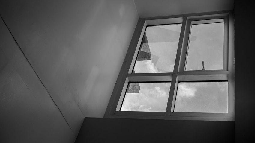 What's on the other side? Freedom Low Angle View Black And White Black And White Photography Built Structure Clear Windows Closed Window  Cloud - Sky Clouds Clouds And Sky Day Glass Window Indoors  Interior Interior Design No People Open Window Sky Window Window Glass Window View EyeEm Ready   EyeEmNewHere