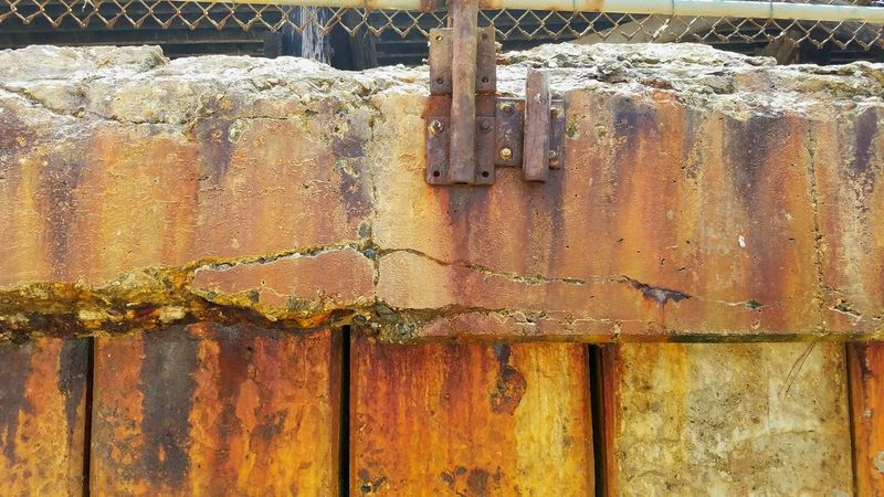 Architecture Wall Breakwall Multi Colored Weathered Close-up Corrugated Iron Pattern Backgrounds Outdoors Textured  No People Dripping Gold Vertical Lines Sections Dramatic Bold Copy Space Rough Yellow Rusted