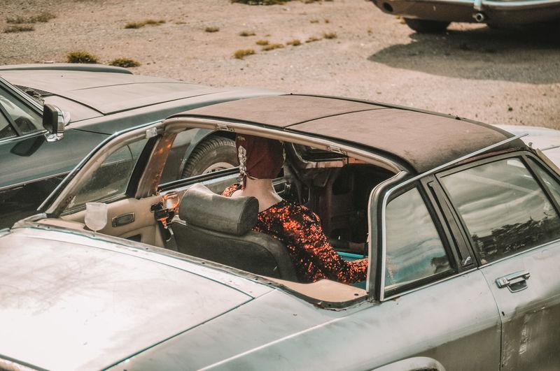 Manikin in junk car