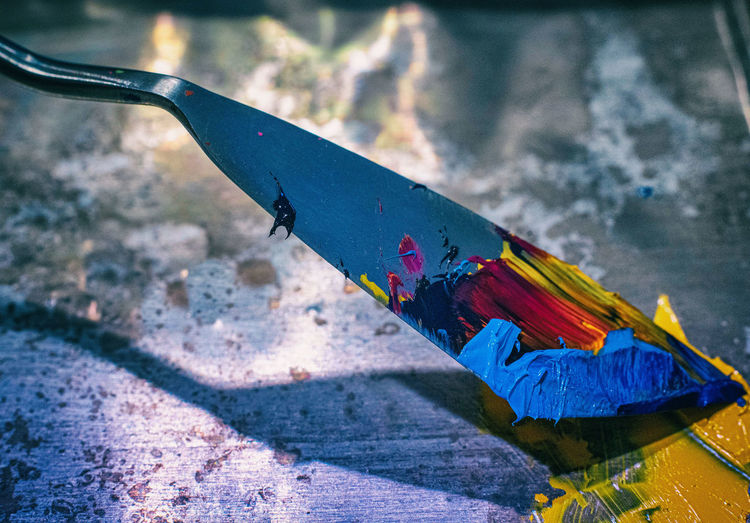 High angle view of multi colored utility knife