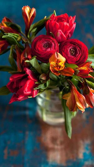 High angle view of fresh flowers bouquet in vase at table