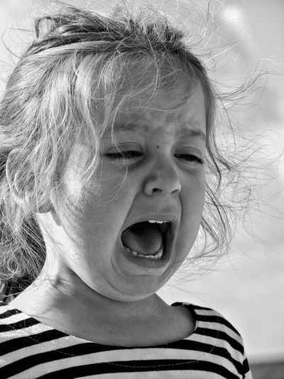 Close-Up Of Crying Girl Shouting