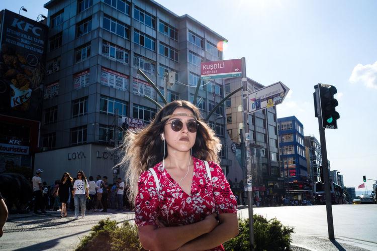 Portrait of woman on street in city