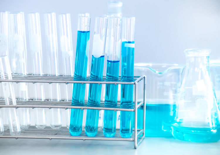 Close-up of blue chemical in container at laboratory