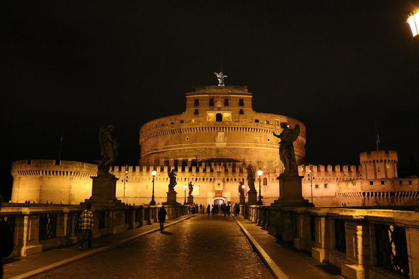 Rom by Night Architecture Building Exterior Built Structure Castle Sant'angelo City City Gate History History Architecture Illuminated Italy Night Night Lights Nightphotography Outdoors People Ponte Sant'Angelo Roma Sky Tourism Travel Travel Destinations EyeEm Diversity Break The Mold Art Is Everywhere TCPM EyeEmNewHere The Architect - 2017 EyeEm Awards The Photojournalist - 2017 EyeEm Awards The Great Outdoors - 2017 EyeEm Awards The Street Photographer - 2017 EyeEm Awards Neighborhood Map Live For The Story Place Of Heart Moving Around Rome