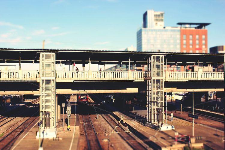 High angle view of railway tracks with footbridge
