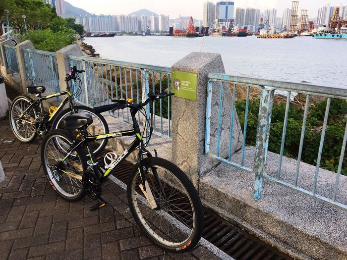 Two people missing in the tour. Bicycle City Mode Of Transport Transportation Architecture Railing Building Exterior Outdoors City Life Built Structure Water Day Stationary Land Vehicle Cityscape No People Nature Sky HongKong Tuenmun EyeEm Lifestyles