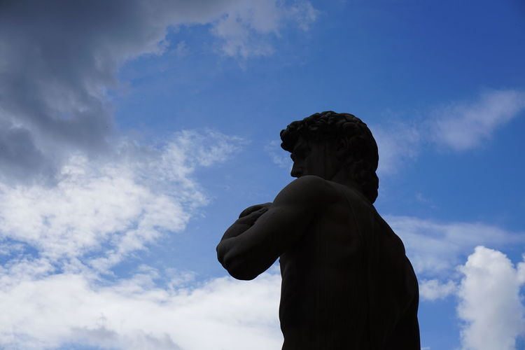 Low Angle View Of Male Sculpture Against Sky